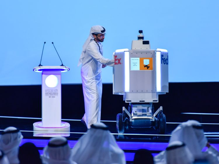 Roxo, a robot used by FedEx in the US, delivers the winners list to the announcer at Dubai World Challenge for Self-Driving Transport 2019 at Dubai World Trade Centre on Tuesday. Roxo will be trailed for the first time outside the US for door-to-door delivery in Dubai under an agreement with the RTA.